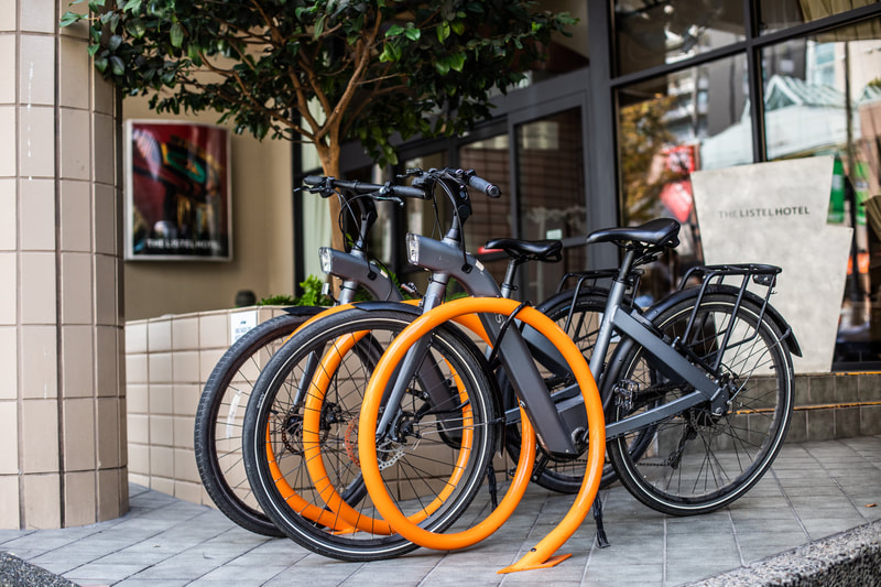 black bicycles at orange bike rack