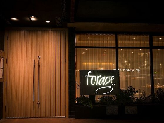 Image of forage restaurant entrance and sign.
